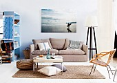 Living room with coffee table & sofa below large photo on wall