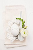 Egg decorated with flower and lace doily