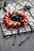 Wreath of rose hips and chokeberries on napkin
