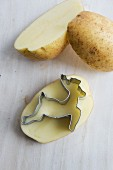 Potato print - deer-shaped pastry cutter on halved potato