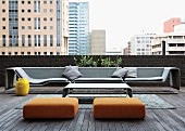 Inviting group of designer seating on loft-apartment terrace with view of cityscape in Johannesburg, South Africa