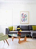 Classic coffee table in front of grey sofa and next to fifties armchair