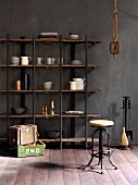 Crockery on open shelves, vintage bar stool and rustic wooden crates