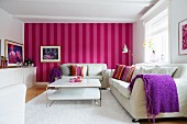 Scandinavian living room with white furniture and red and pink striped wallpaper