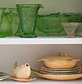 Vintage china crockery and glassware on open-fronted shelves