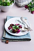 Place setting with wreath of violas and cutlery