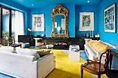 Neoclassical furniture in living room with blue walls and yellow carpet