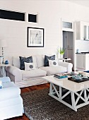 Sofa and white-painted coffee table in rustic living room