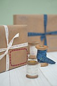Wooden reels and simply wrapped packages with ribbons