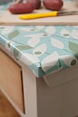 Rustic kitchen table covered in oilcloth