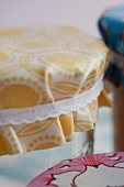 Jars of jam with covers upcycled from oilcloth remnants and ribbons