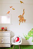 Wall decals of exotic animals in child's bedroom