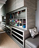 Custom-made, cubic cupboard element in dressing area with drawers, pigeon holes for accessories and closed top unit