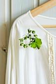 Brooch of lavender sprigs on ladies' blouse