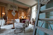 A sales exhibition of antique furniture in the parlour of an old French country house