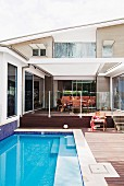 Pool next to terrace of modern, designer house