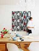 Marimekko fabric wall hanging behind set dining table