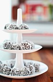 Coconut truffles on white, china cake stand