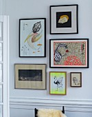 Framed drawings on wall