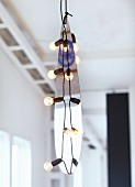 Hand-crafted pendant lamps with metal teardrop amongst light bulbs
