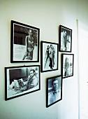 Framed black and white stills from James Bond films on wall