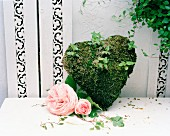 Moss heart and pink roses