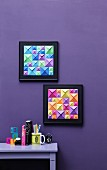 Two frames 3D-effect pictures in op art style made from squares of colourful origami paper