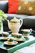 China tea set on green wooden tray