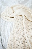 White knitted blanket on bed