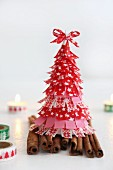 Christmas tree made from washi tape on cinnamon sticks and candles decorated with washi tape