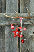 Christmas hanging from antler on wooden wall