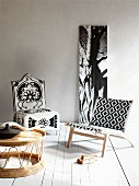 Modern, wooden easy chair with graphic pattern on fabric seat and backrest, floral upholstered chair, photo of tree trunk and wicker coffee table