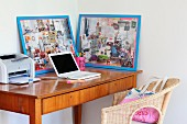 Laptop, printer and framed collages on delicate fifties-style bureau