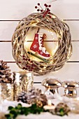 Wicker wreath with fairy lights and ice skate bauble