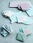 Tiles of different shapes in pale blue and lilac