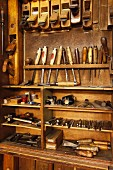 Antique woodworker's cabinet with various tools