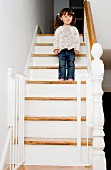 Young girl standing on a staircase