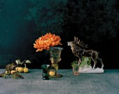 Autumnal still-life arrangement with stag ornament, crab apples & chrysanthemum