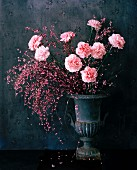 Pink carnations in urn-shaped vase