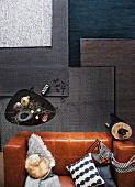 Rugs in shades of grey in living room with coffee table and leather sofa