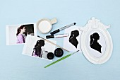 Instructions and craft materials for making paper cut silhouette