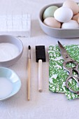 Craft utensils and patterned paper for decorating Easter eggs (decoupage technique)