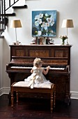 Little girl wearing ruffled dress playing on piano