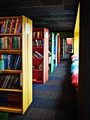 Free-standing colourful bookcases in library