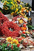 Wreath of rosehips and natural craft utensils on an autumn market stall