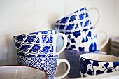 White and blue mugs painted with various patterns