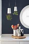 Upside-down planters (Sky Planter) above cooking utensils on kitchen worksurface