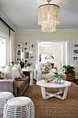 Exotic living room with capiz-shell lampshade, sisal rug and white, modern furniture