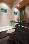Contemporary bathroom with bathtub, washbasin and mirror; Burlington; Vermont; USA