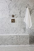 White towel and tap on marble wall in bathroom; Irvine; California; USA